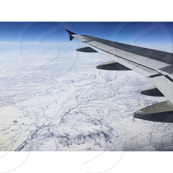 Flying over a snow covered Colorado in May 2014 photo