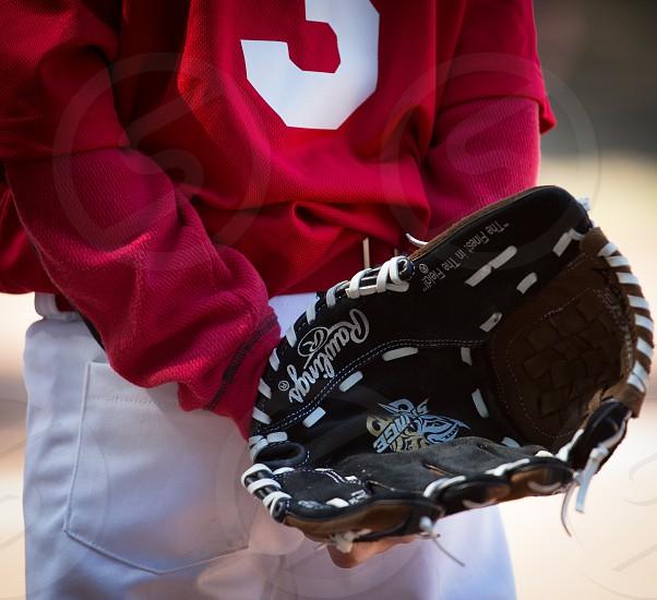 Baseball youth glove in the back photo