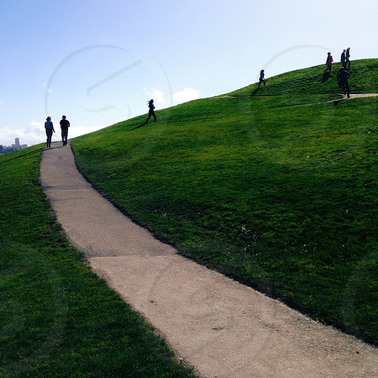 people walking on green grass view photo