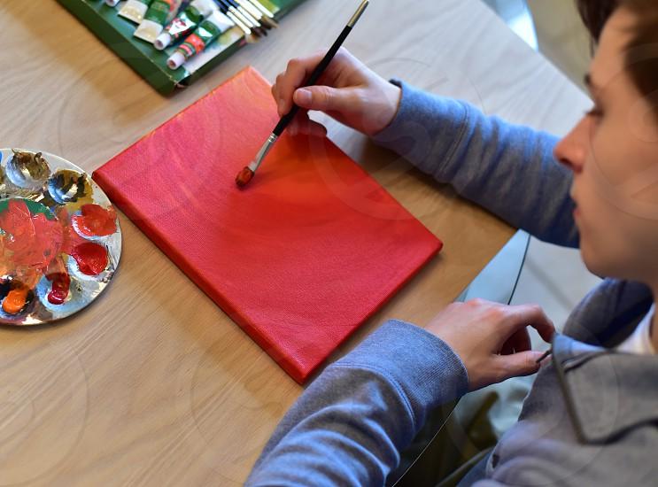 creative kid boy painting photo