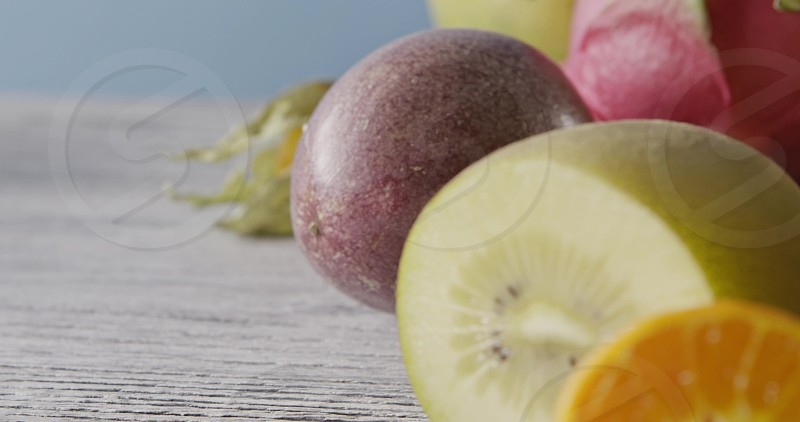 Summer exotic juicy fruits ingredients - carambola litchi passion fruit on a wooden background. Concept of healthy dieting food. Dolly motion 4K UHD video 3840 2160p. photo