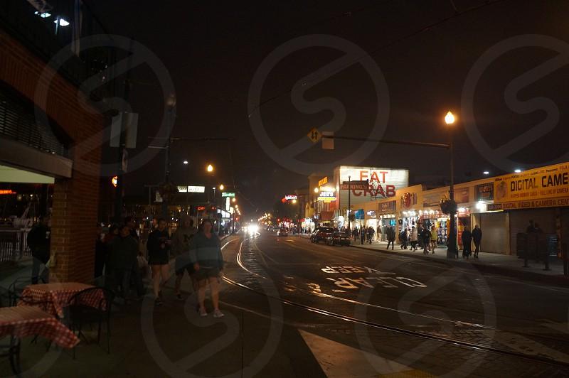 people walking on sidewalk photo