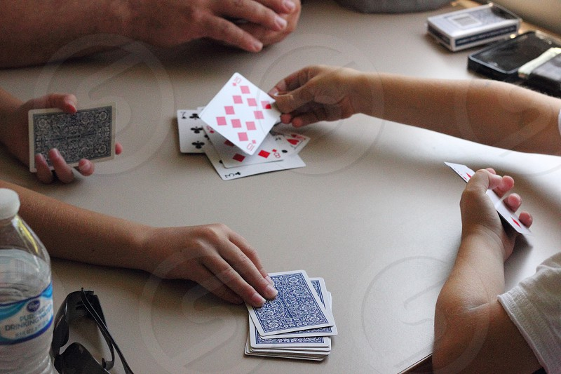 Cards kids man hand indoors hold holding table game photo
