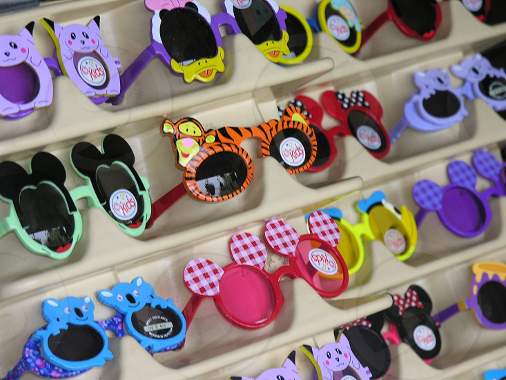 sunglasses children silly colorful vibrant characters rack rows perspective designs imaginative protective healthy choices fashion photo