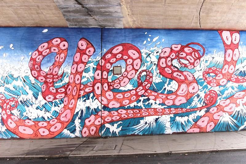 multicolored sea waves wall graffiti photo