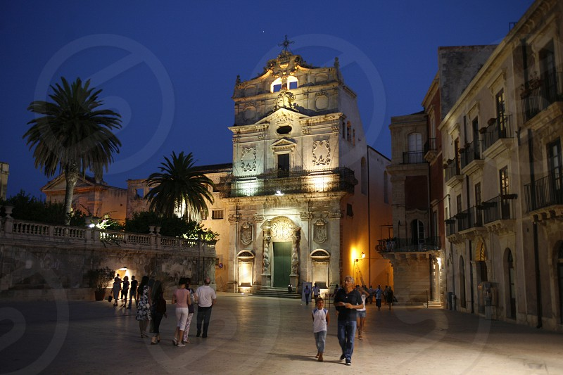 The Piazza del Domo in the old Town of Siracusa in Sicily in south Italy in Europe. photo