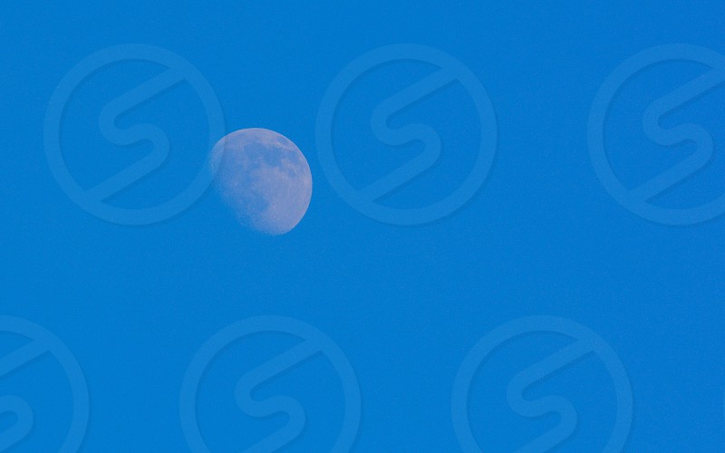moon with blue backdrop photo
