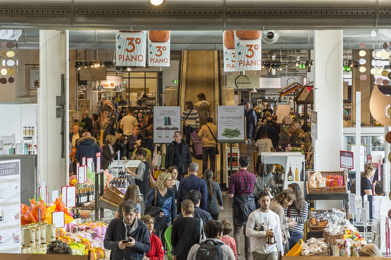 Eataly is the largest Italian marketplace (food hall) in the world comprising a variety of restaurants food and beverage counters bakery retail items and a cooking school.  photo