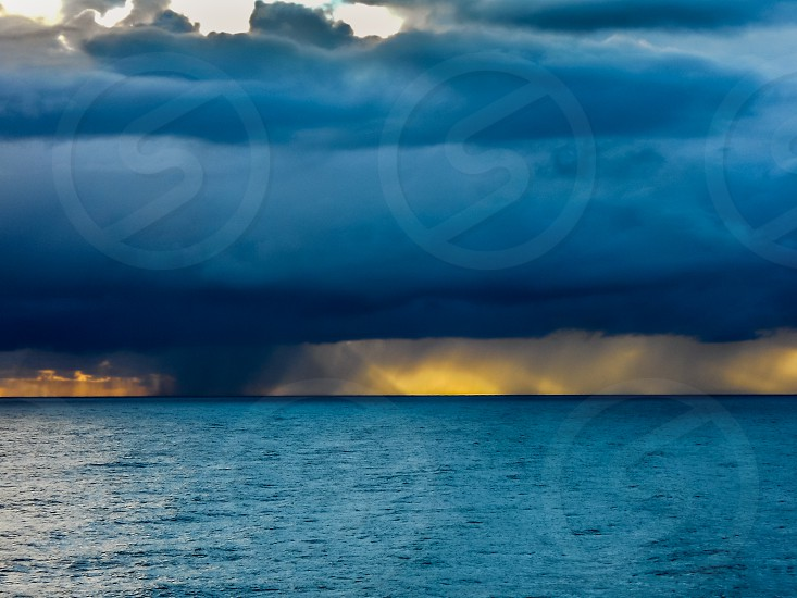photo of ocean and incoming storm photo