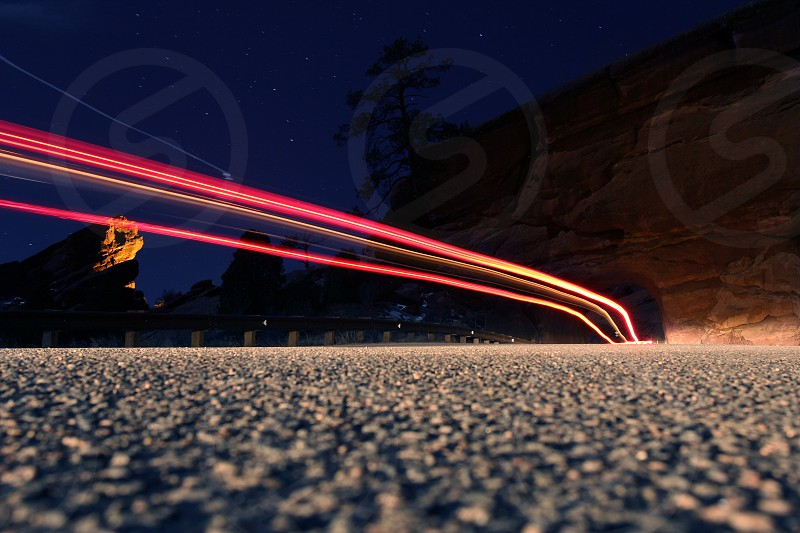 Colorado Night at Red Rocks park as car lights drive by. Taken in May of 2014 photo