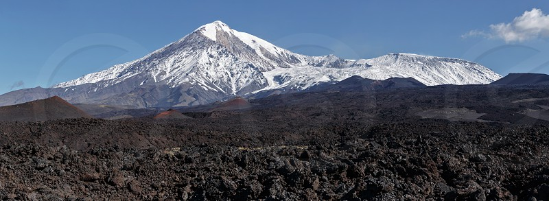 Beautiful volcanic landscape of Kamchatka: panoramic view on lava field active Tolbachik Volcano. Russian Far East Kamchatka Peninsula Klyuchevskaya Group of Volcanoes. photo