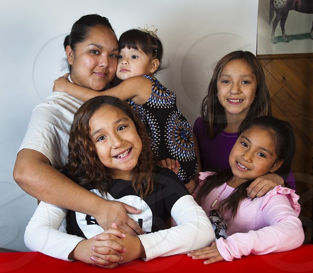 Native American family of cousins with Shoshone woman who is the mother and aunt of this group of children. photo