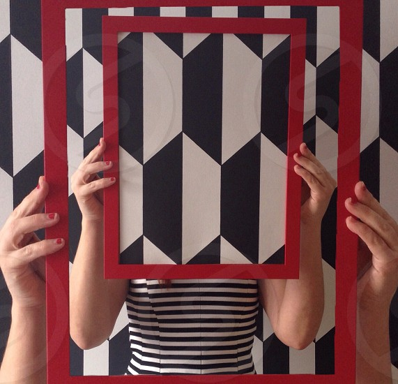 Black white hexagonal shapes in a red frame photo