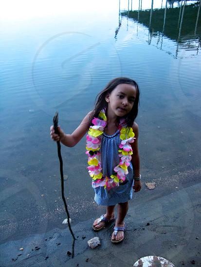 Little Amerasian girl at lake in Georgia  USA  photo