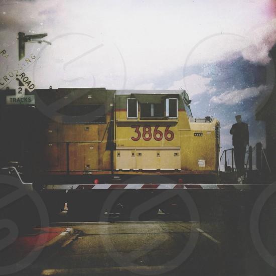 yellow 3866 train crossing railroad 2 tracks photo