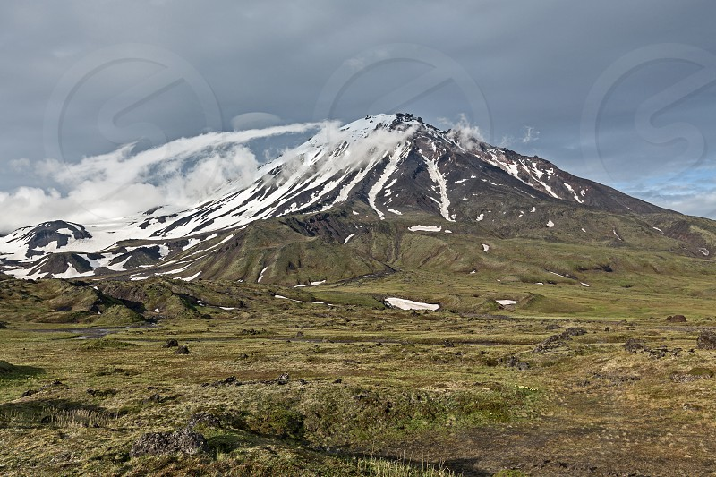 Beautiful mountain landscape on cloudy day: Oval Zimina Volcano in cloudy weather. Eurasia Russia Far East Kamchatka Peninsula  Klyuchevskaya Group of Volcanoes. photo