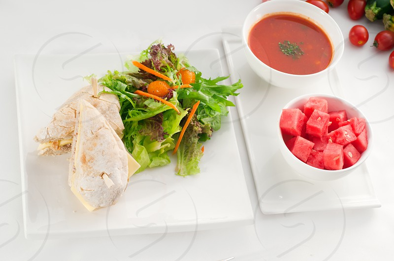 tuna fish and cheese sandwich with fresh mixed salad watermelon and gazpacho soup on sidewith fresh vegetables on background MORE DELICIOUS FOOD ON PORTFOLIO photo