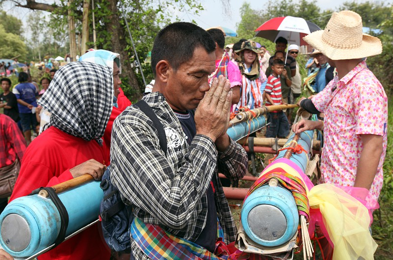 People of a Rocket Team at the Bun Bang Fai Festival or Rocket Festival in the City of Yasothon in the Region of Isan in Northeast Thailand in Thailand. photo