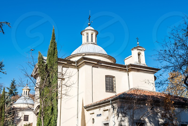 Outdoors view of Royal Chapel of St. Anthony of La Florida in Madrid against blue sky. San Antonio de la Florida photo
