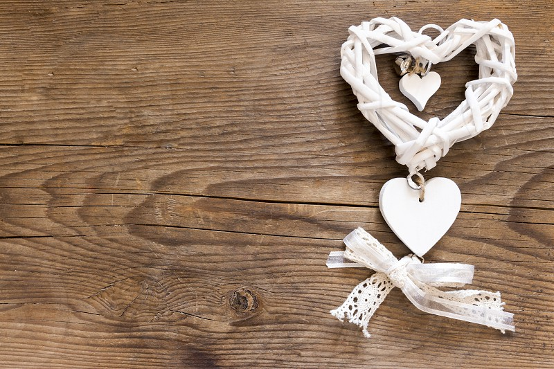 White heart on the wooden background photo