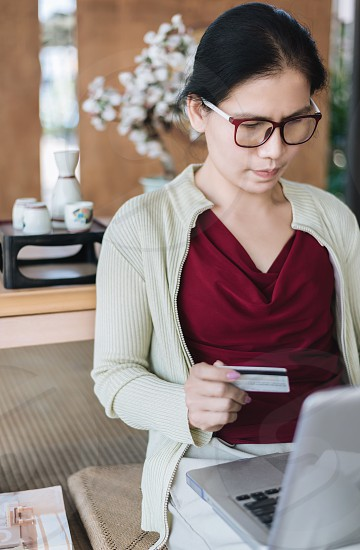 Woman pays by credit card in e-commerce. photo