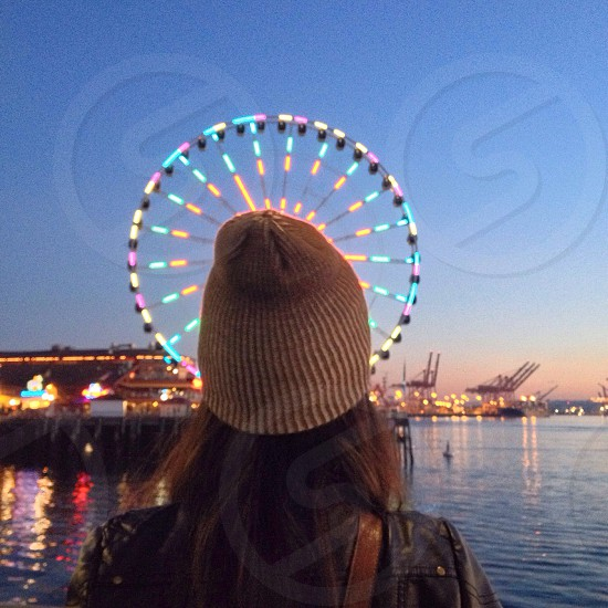 woman wearing gray beanie looking at ferry's wheel photo