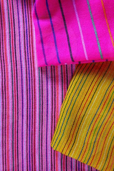 Mexican serape vibrant colorful macro fabric texture background photo