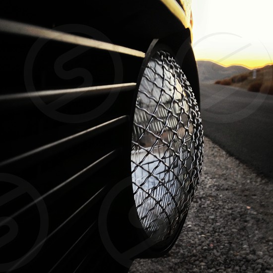 clear round glass headlight with stainless steel net frame photo