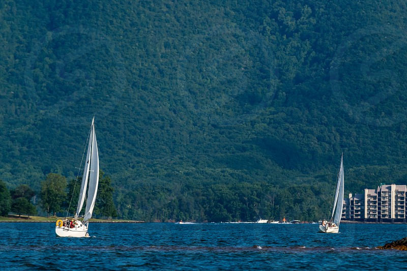 Two sail boats at a lake in Virginia with the mountain in the background photo