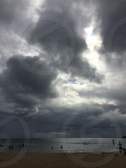 Stormy skies at Ala Moana beach. (portrait)  photo