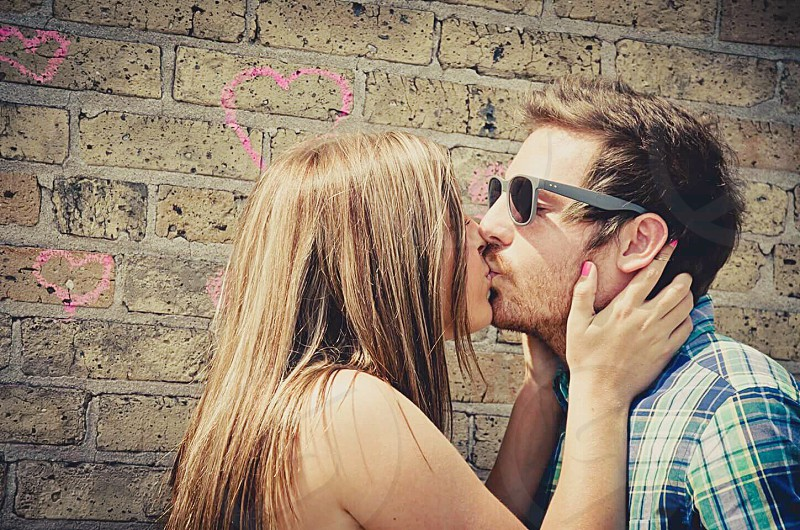 Love engaged couple kissing happiness photo