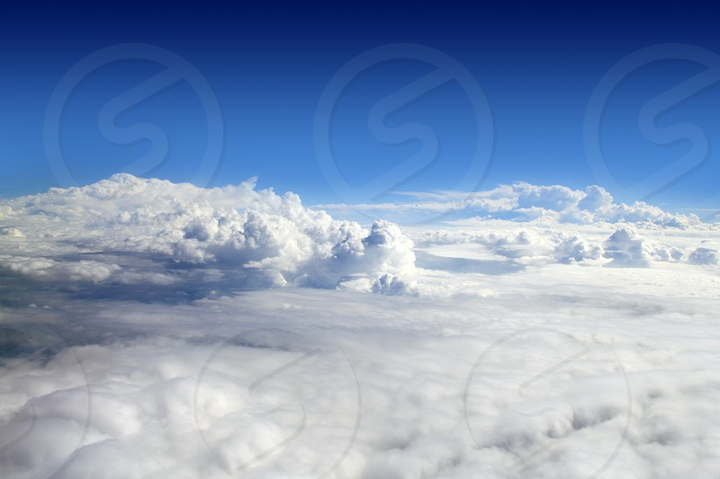 blue sky high view from airplane clouds shapes photo