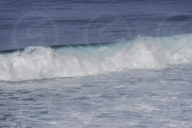 background of rolling wave in atlantic ocean on the madeira coast photo