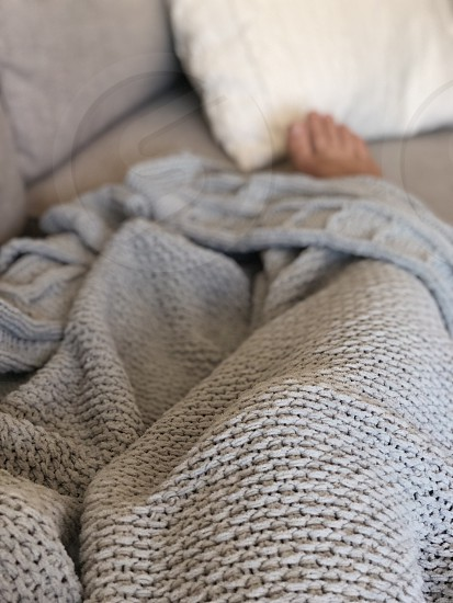 Life as a renter couch blanket relaxing feet person  photo