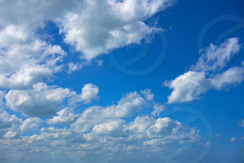 Blue sky summer white cumulus clouds background photo