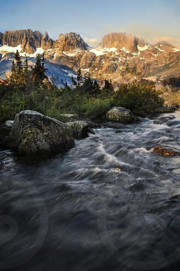 River flow out of a lake at sunrise photo