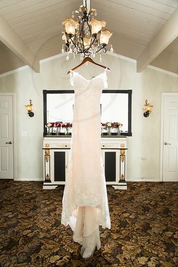 A brides wedding dress waiting to be worn.  photo