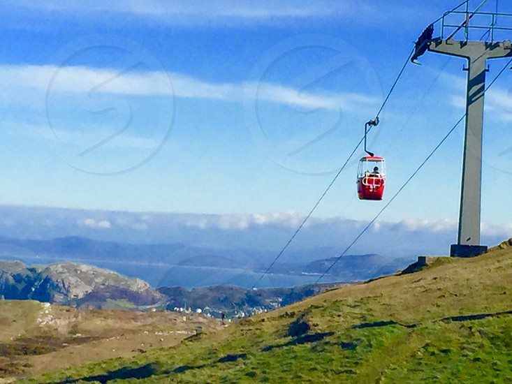 red cable car during daytime photo