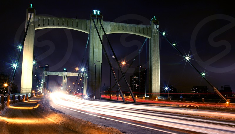 A bridge stretches along the sky while cars drive across it in the Minneapolis MN winter. photo
