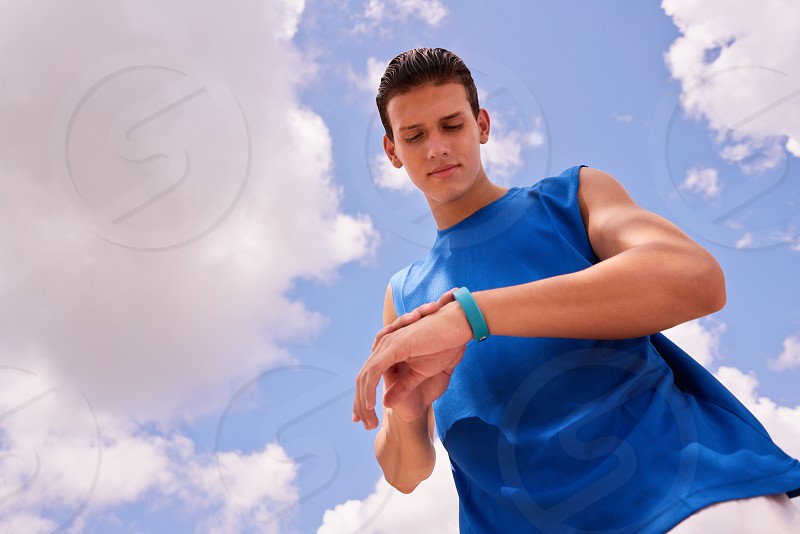 fit watch running sports jogging man sky clouds activity athlete body bracelet copyspace copy space counter equipment exercise exercising fitwatch fitband fitness happy health heart heart beat hispanic jogger leisure looking outdoor people persons programming rate run runner smartwatch smiling sport sporty steps technology time tracker training wearable working out wrist young photo