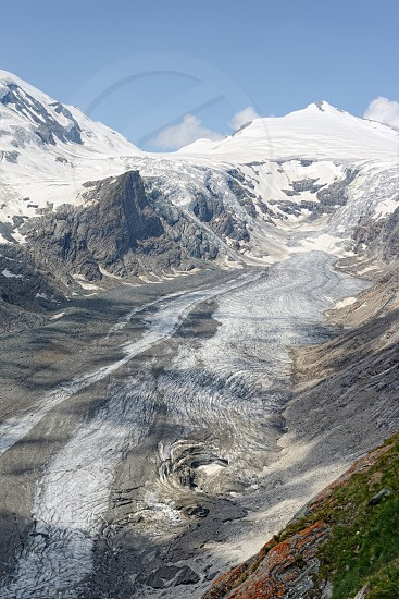 Pasterze Glacier at Grossglocker mountain area with snow in summer time. photo