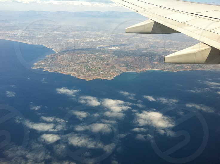wing airplane ocean sea blue photo