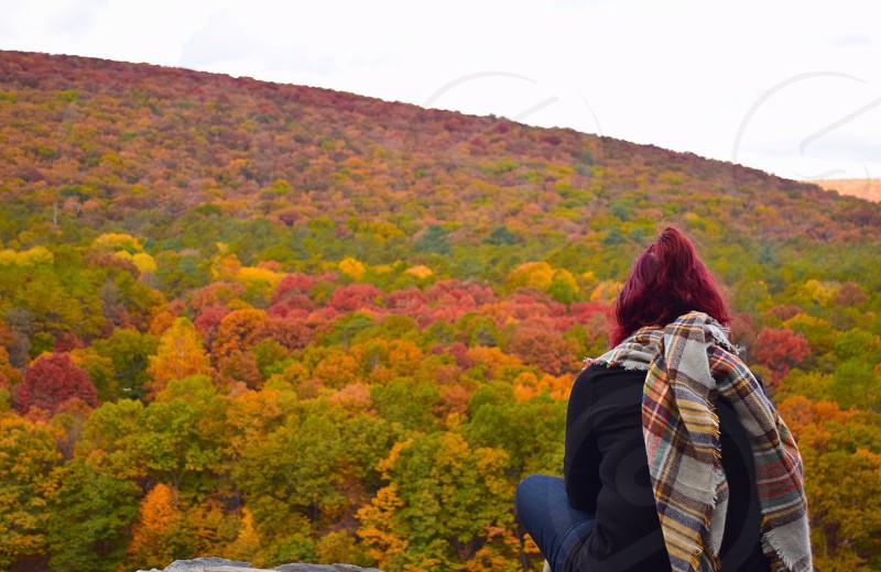 Vibrant color: Autumn female leaf peeping photo