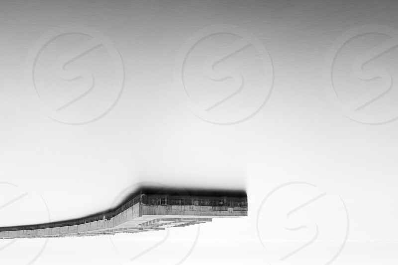 abstract minimal breakwater in black and white photo