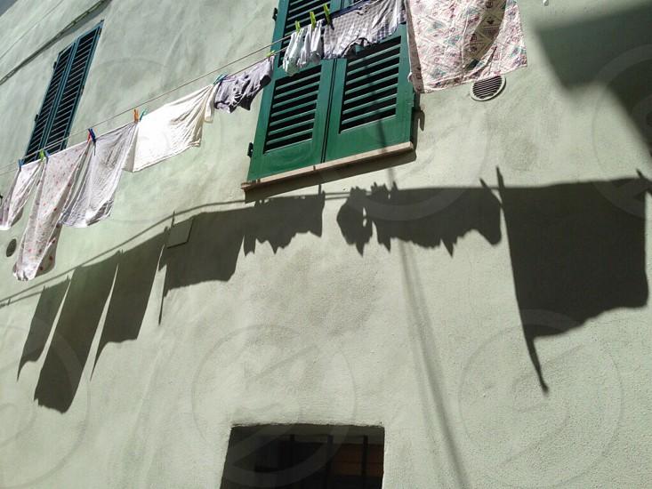 Green shutter laundrybuilding wall photo
