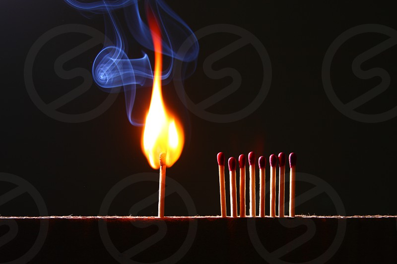 flaming match near 8 unflamed match photo