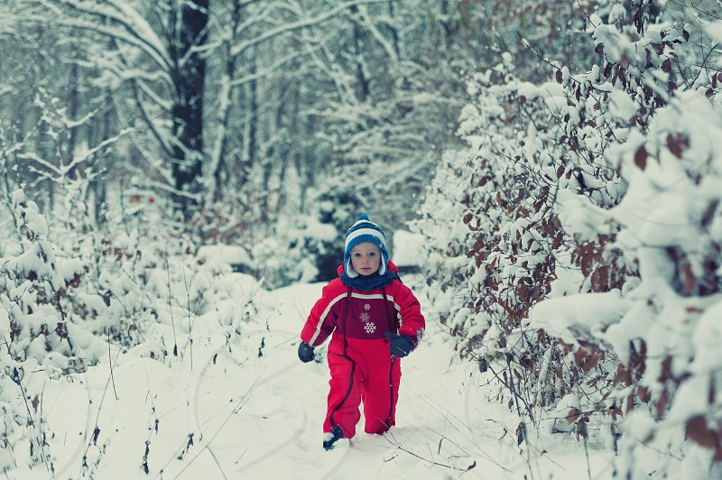 Small boy playing in the snow photo