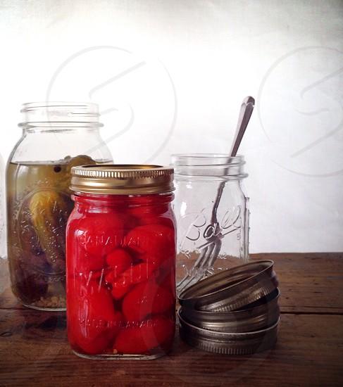 3 glass jars and 3 lids photo