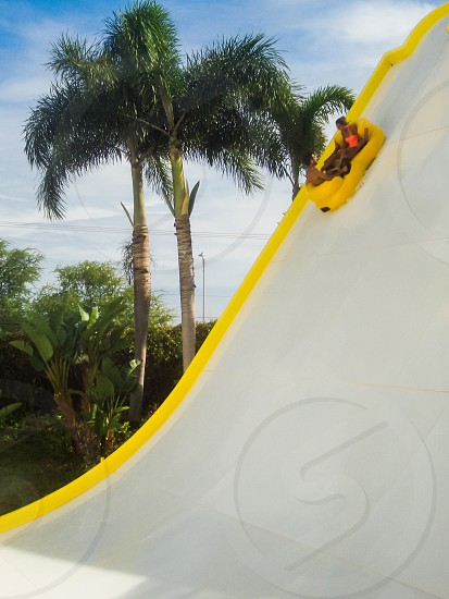 Waterslide couple fun at a water park Hawaii photo