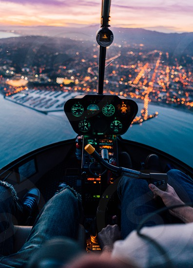 helicopter explore wanderlust fly aerial sunset twilight santa barbara airborne pilot lights city feet sky harbor sea coast vacation southern california photo